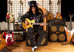 Slash va canta live alaturi de Fergie (video)